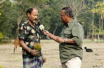 215px-Shykh_Seraj_interviews_a_farmer